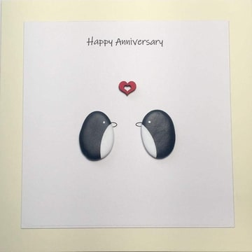 Two penguins looking at each other, red heart above, white background yellow card -  Size: 6x6 - Greeting: Happy Anniversary.