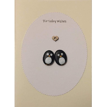 Two penguins below a heart, white oval background on yellow card -  Size: 7x5 - Greeting: Birthday Wishes