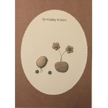 Pebble bird next to flower pot, white oval background on brown kraft card -  Size: 7x5 - Greeting: Birthday Wishes