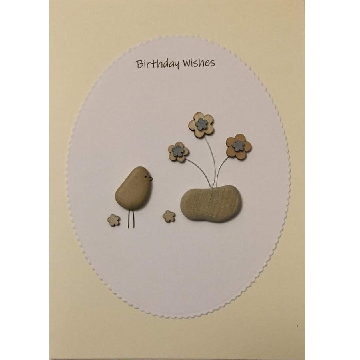 Pebble bird next to flower pot, white oval background on yellow card -  Size: 7x5 - Greeting: Birthday Wishes