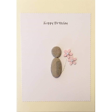 Pebble figure holdinga flower, white rectangle background on yellow card -  Size: 7x5 - Greeting: Happy Birthday
