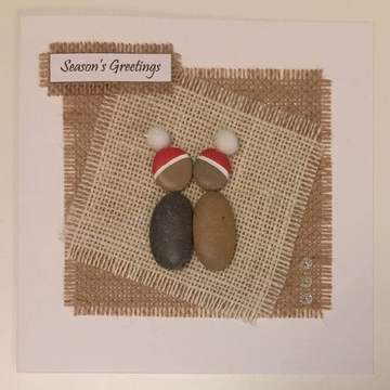 A pebble couple with xmas hats kissing, hessian square, white background on white card -  Size: 6x6 - Greeting: Season's Greetings