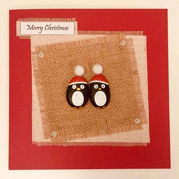 Two penquins with xmas hats, hessian square on fabric square, red background on white card -  Size: 6x6 - Greeting: Merry Christmas