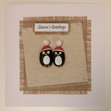Two penquins with xmas hats, fabric square on hessian square, white background on white card -  Size: 6x6 - Greeting: Season's Greetings.
