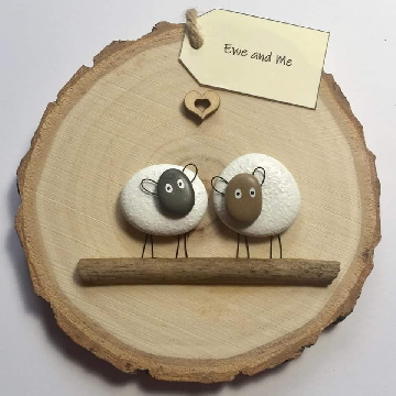 Two sheep standing on driftwood with a heart..Ewe and Me...