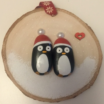 Two penquins wearing xmas hats...Tag...None...